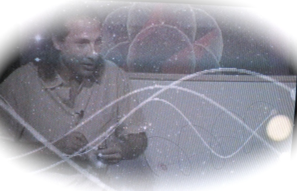 N.Haramein demonstrates solar system spiral momentum - photo from TV