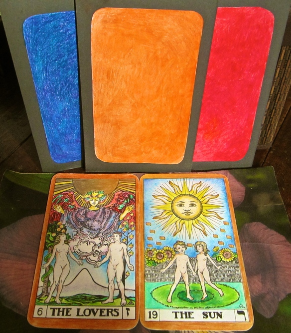 A healing colour combination, the other day.  The blue is meant to be indigo, but my camera saw it differently.  Indigo is Saturn, Orange is Sun and Red is Mars.  Tarot Keys the Lovers and the Sun are both in the solar orange frequency:  the tone is D-natural.
